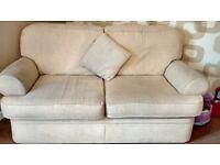 2 x2 seater cream sofas £50