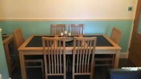Dining table and 6 chairs with black marble and matching cabinet