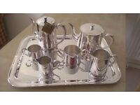 Silver plated tea- and coffee-pot, creamers,sugar on serving tray