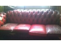 chesterfield oxblood red sofa's needs attention on the arm and cushion seats are worn in places.