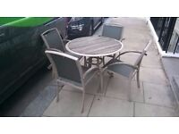 Quality patio round 100cm table and four ergonomic chairs central London bargain