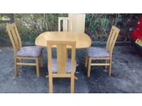 Stylish Scandinavian extending table with 4 chairs
