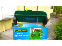 NEW Evergreen easy spreader plus lawn seed, weed and feed, never used.