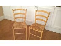 Four Kitchen/dining chairs. Solid beech with rush seats. Very good condition. JL.