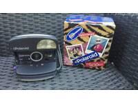 Polaroid coolcam instant camera.