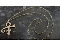 Amazing long yellow gold chain with a pendant. Perfect gift.