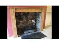 Large wooden fire surround offers welcome