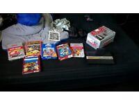boxed Atari 2600 jr console and 7 games boxed