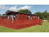 Corner pitched holiday lodge for sale at Yaxham Waters Holiday Park in the heart of rural Norfolk