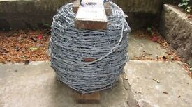 Roll of Barbed Wire 200m but some used