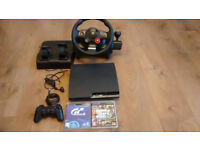 PS3 with 2 games and a logitch steering wheel.