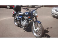 Royal Enfield Woodsman - the one that stands out and attracts attention