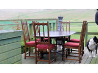 ERCOL DINING TABLE AND SIX ERCOL CHAIRS