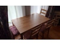 Wooden dining table with 4 chairs with cushions