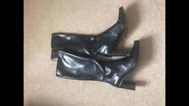 Ladies knee length black leather boots. Unwanted gift. Still in box,