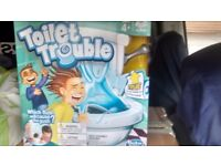 Toilet trouble board game , made by hasbro. Brand new and unopened
