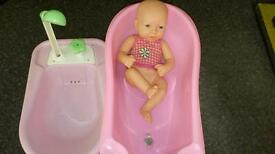 Doll and two baby baths