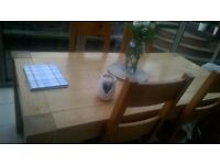 beautiful solid pine oak table and four chairs