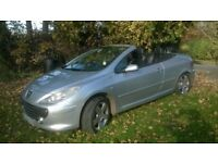 peugeot 307 convertable metalic silver car in very good condition inside and out 6 speed manual box