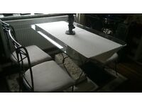 Glass table and iron chairs.look