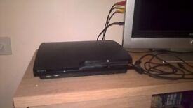 playstation 3 with 2 pads 3 games + 3 built in games