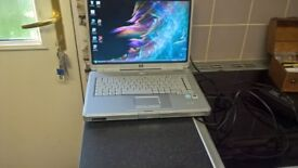 hp g5000 with universal charger