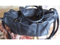 Used H&M Black Bag. Size - medium. Good condition, the zipper on the bag does not work.