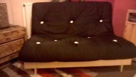 4ft black futon. Folds out into a small double bed. Collection from New Gallaway.