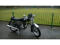 honda cg125 cafe .. nice bike, real head turner.. 12 months m.o.t done yesterday