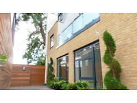 A stunning three bedroom newly built mews house set behind private gates close to tube