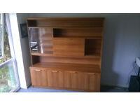 Teak effect living room unit/cabinet with glass sliding doors