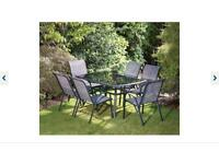 Patio table and 6 chairs garden set