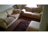 cream suede sofas & footstool can deliver