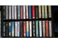 Selection of cassette tapes in case.