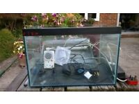 Tropical fish tank with flouresent light, heater,aerator and fish scoop. Aluminium lid.