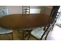 Solid Elm 'Ercol' dining table and four chairs.