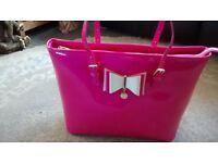 large pink patent bag