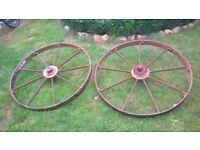 A pair of vintage metal wheels