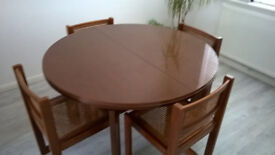For sale extendable round dining table and 4 cane chairs