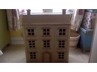 Wooden Dolls House as new complete with figures and furniture.