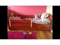 Unisex children bed with mattress and storage.
