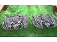 Pair of Bats in stone
