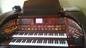A Lowry Stardust Electric Organ, Including Stool And Manuals As Pictured.