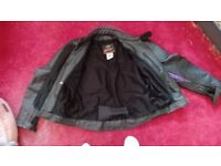 "Black leather motorcycle jacket (44"")"