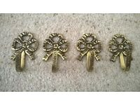 Antique brass ornate bow hooks/curtain tiebacks set of four Collect only