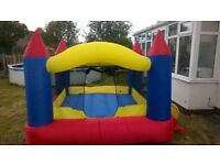 Indoor/Outdoor bouncy castle with pump - inflates/deflates in seconds