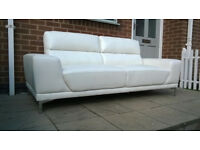 Brand New Manhatan 3 Seater Ivory Leather Sofa on Chrome feet.