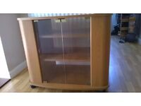Glass fronted TV stand/cabinet with storage at the sides and underneath .