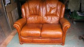A pair of two seater leather sofas.