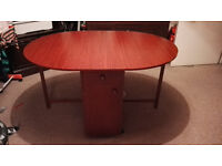 Butterfly Folding Compact Wheeled Table With Storage - Mahogany Color - Space Saver